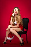 Sexy santa helper on red background Royalty Free Stock Image