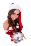 Sexy santa holding a disco ball Royalty Free Stock Image