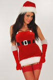 Sexy santa in mini skirt Royalty Free Stock Images