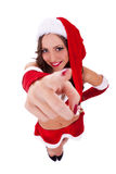 Sexy santa pointing to you Stock Images