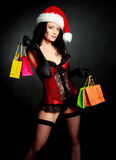 Sexy Santa with presents Royalty Free Stock Images
