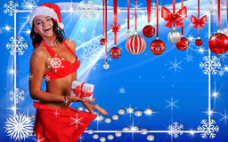 Sexy Santa's Helper Girl holding a gift box. Happy Winter Holidays postcard, wallpaper template  with Sexy Santa's Helper holding a gift box and showing how she Stock Photography