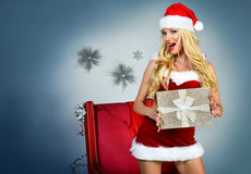 Sexy Santa`s Helper Holiday postcard. Royalty Free Stock Photo