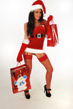 Sexy santa with shopping bags Royalty Free Stock Image