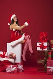 Sexy santa with stack of gifts Royalty Free Stock Image