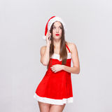 Sexy santa woman calling Stock Photo
