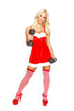 Sexy santa woman with dumbbells. Isolated on white Royalty Free Stock Images