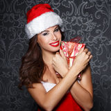 Sexy santa woman embrace christmas gift Royalty Free Stock Photos