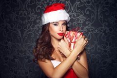 Sexy santa woman embrace christmas gift Royalty Free Stock Photo