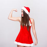 Sexy santa woman in hat showing biceps Stock Image