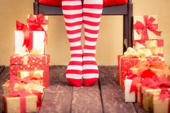 Sexy Santa woman legs Stock Photos
