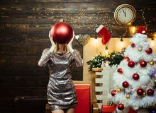 Santa woman posing on vintage Christmas background. Christmas tree decorate at home. Beautiful smiling woman wishes. Merry Christmas. Funny stock images
