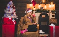 eddd7ebdd Sexy Santa woman posing on vintage Christmas background. Glamour  celebration new year. Blonde female