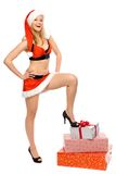 Sexy Santa woman with presents Stock Photos
