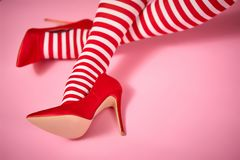 Santa woman`s legs on a pink background. Santa woman`s legs on a light pink background royalty free stock image
