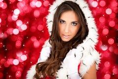 Sexy santa woman on shiny background Stock Image