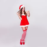 Sexy santa woman with smartphone Stock Images