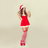 Sexy santa woman with smartphone Stock Photography