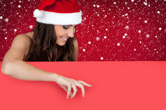 Sexy santa woman, snow and billboard Royalty Free Stock Images