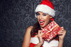 Sexy santa woman surprise with gift Royalty Free Stock Photo