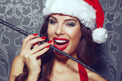 Sexy santa woman with whip vintage Royalty Free Stock Photo