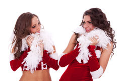 Sexy santa women looking at each other Royalty Free Stock Image