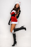 Sexy Santas Helper girl great image for creating Holiday Greeting postcards Stock Images