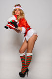 Sexy Santas Helper girl great image for creating Holiday Greeting postcards Royalty Free Stock Images
