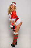 Sexy Santas Helper girl great image for creating Holiday Greeting postcards Stock Photography