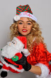 Sexy Santas Helper girl great image for creating Holiday Greeting postcards Royalty Free Stock Image