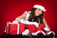 Sexy santas helper wrapping Christmas presents Stock Images