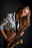 Sexy saxophone blonde player dreaming Royalty Free Stock Image