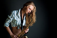 Sexy saxophone blonde player dreaming Stock Photos