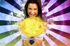Sexy schoolgirl making a fireball. On a cosplay theme Stock Photo