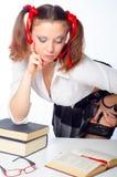 Sexy schoolgirl reading the book Stock Photos