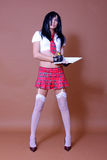 schoolgirl standing pose Stock Photo
