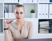 secretary with glasses in hand undresses in office, flirt and desire. Office provocation. royalty free stock photo