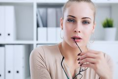 Sexy secretary with glasses in hand undresses in office, flirt and desire. Office provocation. Sexy secretary in glasses undress in office, flirt and desire Royalty Free Stock Photo