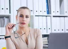 Sexy secretary in glasses undresses in office, flirt and desire. Office provocation. Sexy secretary in glasses undress in office, flirt and desire Royalty Free Stock Image