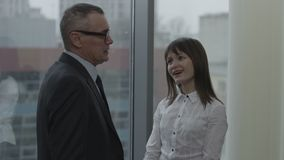 Sexy secretary and her boss flirting in office stock video