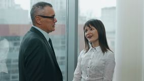 Sexy secretary and her boss flirting in office stock video footage