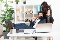 Secretary personal assistant. Typical office life. Man bearded hipster boss sit in leather armchair office interior. Boss and secretary girl at workplace royalty free stock photos