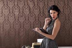 Sexy secretary provocating clients, vintage scene Royalty Free Stock Photos