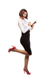 Sexy secretary with red high heels using tablet. Studio. White background Stock Images