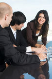 secretary with two businessmen Stock Photo
