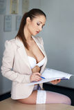 Sexy secretary in underwear on desk Royalty Free Stock Images