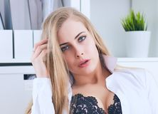 Sexy secretary undresses in office, flirt and desire. Office provocation. Sexy secretary undress in office, flirt and desire Royalty Free Stock Images