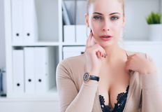 Sexy secretary undresses in office, flirt and desire. Office provocation. Sexy secretary undress in office, flirt and desire Stock Image