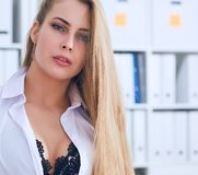 Sexy secretary undresses in office, flirt and desire. Office provocation. Sexy secretary undress in office, flirt and desire Stock Images