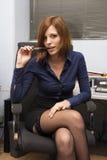 Sexy Secretary. Very beautiful young model posing as a sexy secretary Royalty Free Stock Image